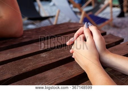 Young Woman Hands With Light Blue Painted Nails, Folded Hands Nervous Gesture, Hands Together On The