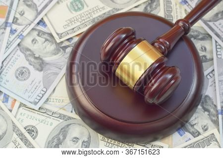 Judge Gavel And Money On Brown Wooden Table. Many Hundred Dollar Bills Under Judge Malice On Court D