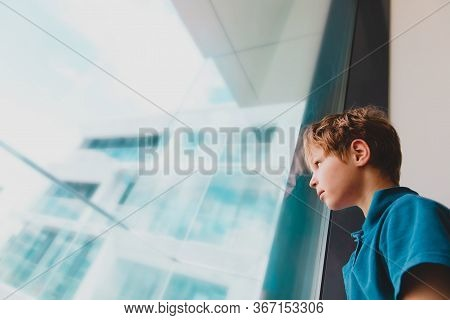 Boy Feeling Anxiety And Stress From Social Isolation, Kid Looking At The Window