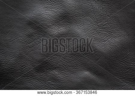 Crumpled Texture Of Black Cowhide, Closeup. Volumetric Background.