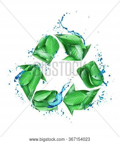 The Sign Of Recycling Created From Fresh Green Leaves With Water Drops. 3d Illustration