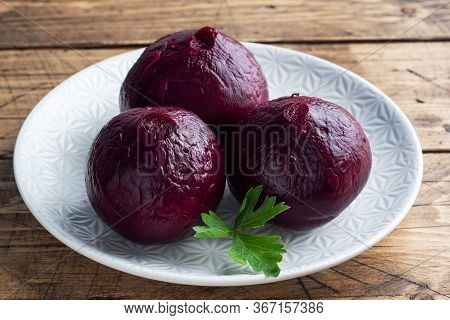 Boiled Beets Whole And Cut On A Cutting Board With Parsley Leaves On A Wooden Rustic Background. Cop