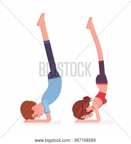 Young Yogi Man And Woman In Sports Wear Practicing Yoga, Partners Doing Pincha Mayurasana Pose, Hand