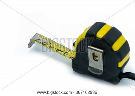 The Retractable Yellow Metal Measuring Tape Isolated On A White Background. Measurements Expressed I