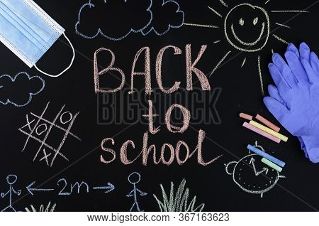 Back To School Background Written By Crayons On The Blackboard Also With Face Mask And Latex Gloves