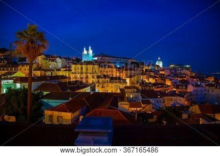 Night View Of Alfama District And Santo Estevao Church Seen From Miradouro Das Portas Do Sol View Po