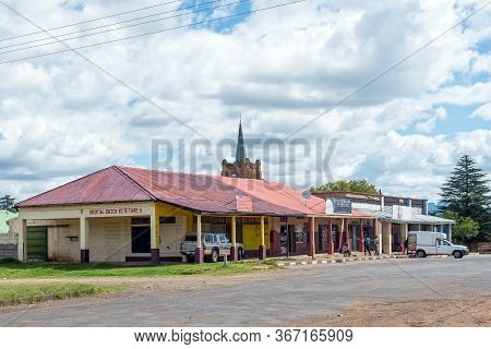Fouriesburg, South Africa - March 18, 2020: A Street Scene, With Businesses, People And Vehicles, In