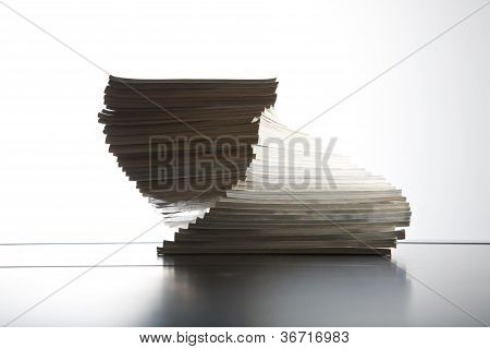 Magazines Piled On Table