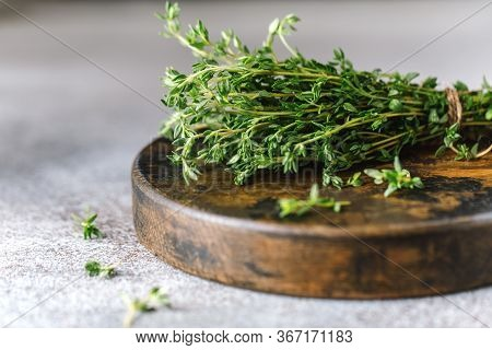 Close Up View Of Thyme Bunch. Herb Thyme On Table