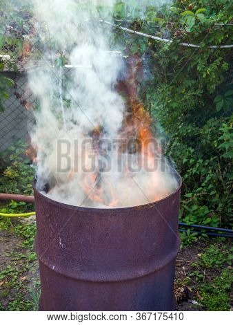 Waste Incineration In An Old Barrel In The Country
