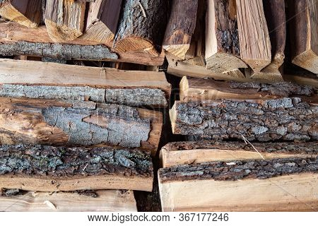 Close Up Woodpile Of Pine Firewood. Texure. Stack