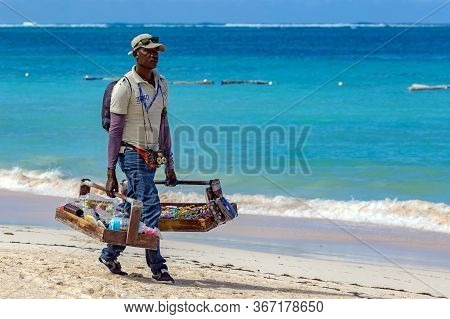 Punta Cana, Dominican Republic - March 11, 2020: Portrait Of A Dominican Man Presenting His Offer Of