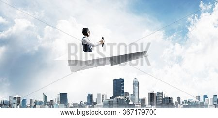 Business Motivation Concept With Pilot Sitting In Paper Airplane. Funny Man In Aviator Hat And Goggl