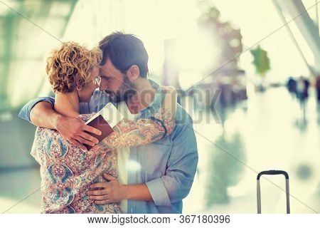 Wife reuniting with husband in airport