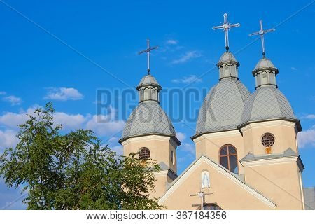 Church Dome At Sunset, Catholic Church With Three Domes In The Blue Sky