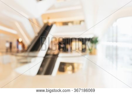 Abstract Blurred Photo Of Luxury Shopping Mall Background. Blurred Of Hallway In Modern Minimal Desi