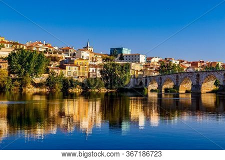 Old Stone Bridge Of Zamora And The Old Town View With The Douro River. Spain