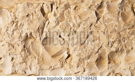 Wall Sandstone Texture Background. Yellow Old Grunge Surface, Stone Vintage Texture. Voluminous 16:9