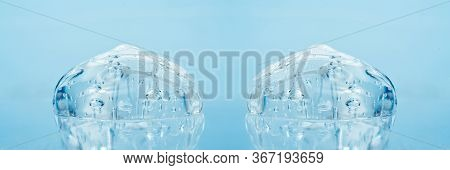 Texture Of Hyaluronic Acid, Serum Gel, Silicone Implants, Transparent Smear Of Gel On Blue Backgroun