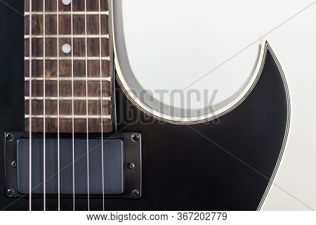 Black Electric Rock Guitar With Humbucker Pickup Close Up Macro Shot