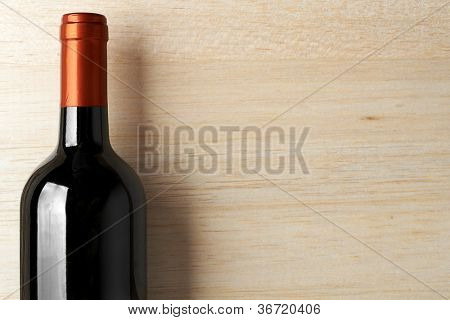 Wine List Design Series: Bottle of red wine over wooden banner