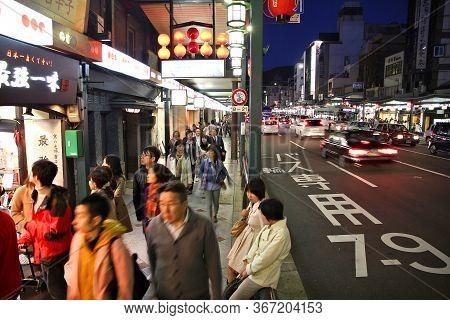Kyoto, Japan - April 14, 2012: People Visit Night Shijo-dori Street In Kyoto City, Japan. Kyoto Was