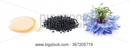 Black cumin oil. Black cumin seeds. Nigella sativa flower.