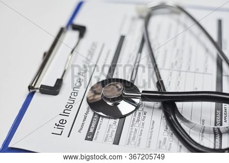 Life Insurance Industry. Individual Medical Health Insurance Policy And Stethoscope
