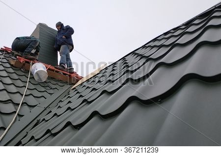 Working With Roofing Material, Metal Roof, Hand Tools Screwdriver.