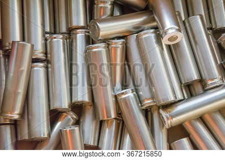 Set Of Machined Metal Parts. Cylindrical Parts, Spare Parts, Batteries. Abstract Industrial Backgrou