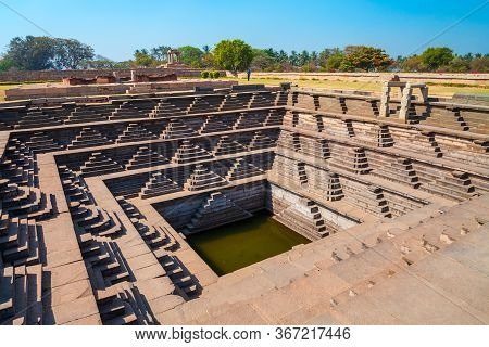 A Stepped Square Water Tank At Hampi, The Centre Of The Hindu Vijayanagara Empire In Karnataka State