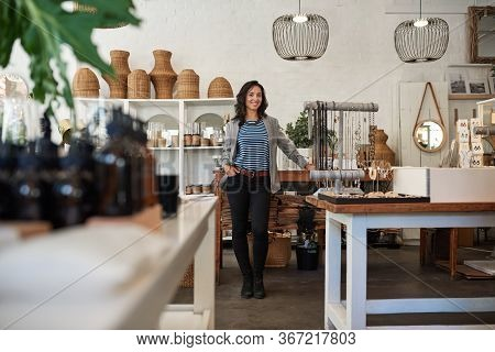 Smiling Asian Woman Standing In Her Trendy Housewares Store