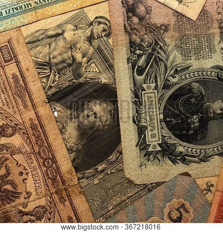 Background From Old Vintage Various Banknotes. Collectible Retro Banknotes From Different Countries.