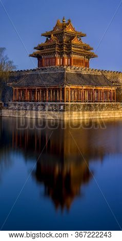 Northwestern Tower Of The Forbidden City Reflecting In The Water In Beijing