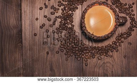 Natural Coffee Beans Arabica. Arabica Coffee. Cup Of Coffee Wooden Table.