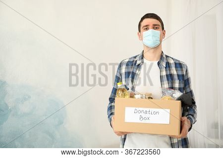Young Man Holds Donation Box. Volunteer. Covid 19