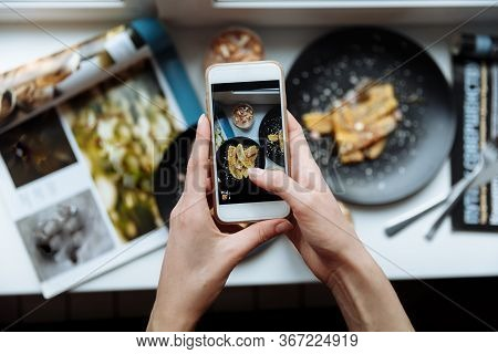 Woman Taking A Photo Of Breakfast With Smartphone, Hands Hold Phone, Frome Above