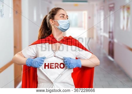 The Doctor, Wearing Medical Mask, Gloves And A Superhero Cape, Tears Open The Coat, Showing The Insc