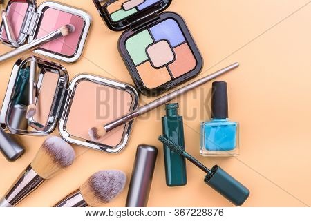 Flat View Of Cosmetics - Lipstic, Face-powder, Brushes, Nail Polish.