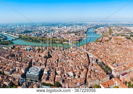 Toulouse And Garonne River Aerial Panoramic View. Toulouse Is The Capital Of Haute Garonne Departmen