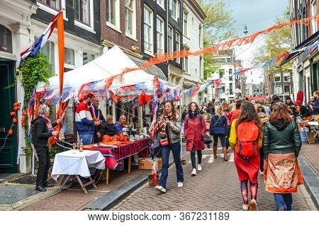 Amsterdam, Netherlands - April 27, 2019: People Buying And Selling On The Traditional Flea Market Du