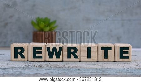Rewrite Word On Cubes On An Old Gray Background With Cactus. Business Concept.