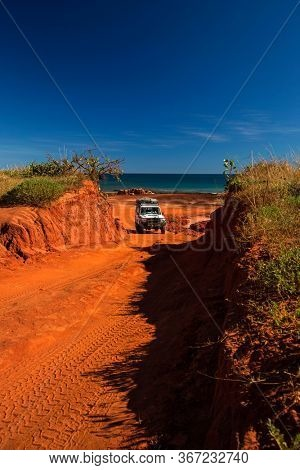 Western Australia – Outback track with 4WD car going uphill from the ocean at Dampier Peninsula