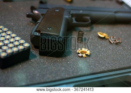 Cartridges Pistol. The Gun Is Next To The Cartridges. Weapon Suitcase For The Gun. Buying Weapons. C