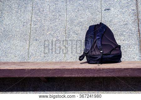 Forgotten Backpack On The Bench. Forgotten Bag