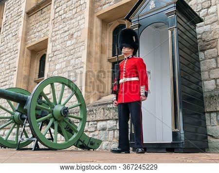 London, Uk - April, 2019: Soldier Of Royal Guard Of London. Soldier Of English Guard Patrols Inside