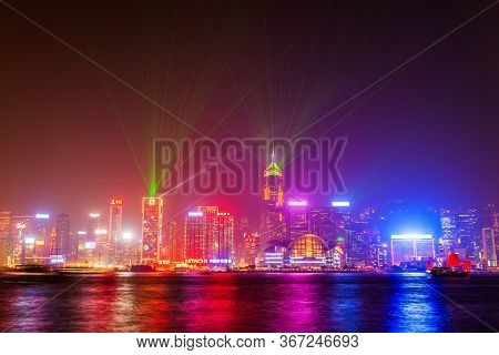 Hong Kong - February 21, 2013: Hong Kong Island Skyline With Light Show Viewed From The Victoria Har