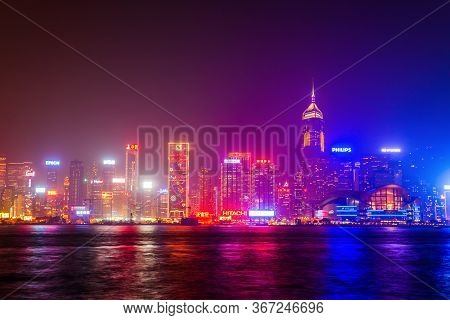 Hong Kong - February 21, 2013: Hong Kong Island Skyline Viewed From The Victoria Harbour Waterfront