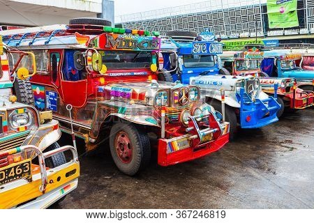 Manila, Philippines - February 25, 2013: Jeepneys Are Popular Public Transport In The Philippines, T