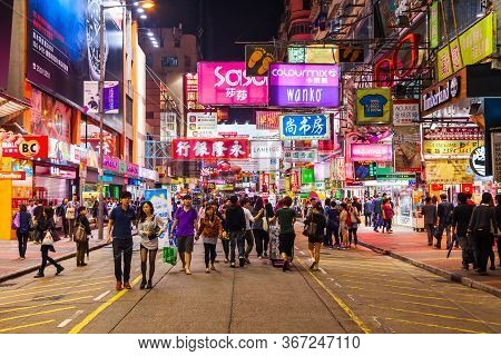 Hong Kong - March 19, 2013: Unidentified People And Signboards With Neon Light Advertisement On Mong
